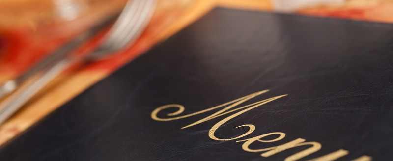 laminated menu on table